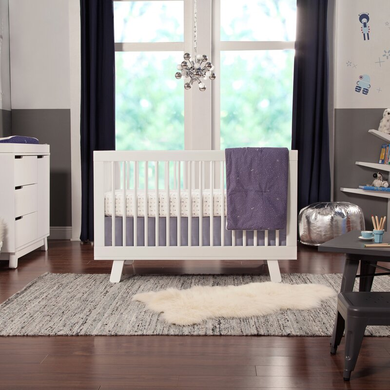 white baby cot in nursery