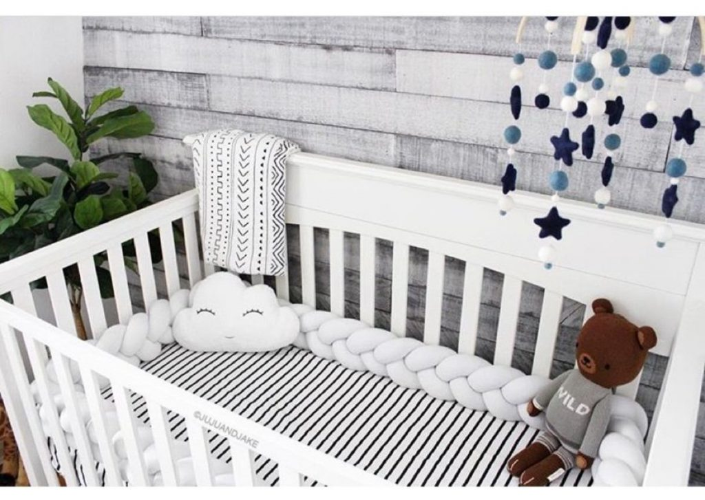white cot with white decorations
