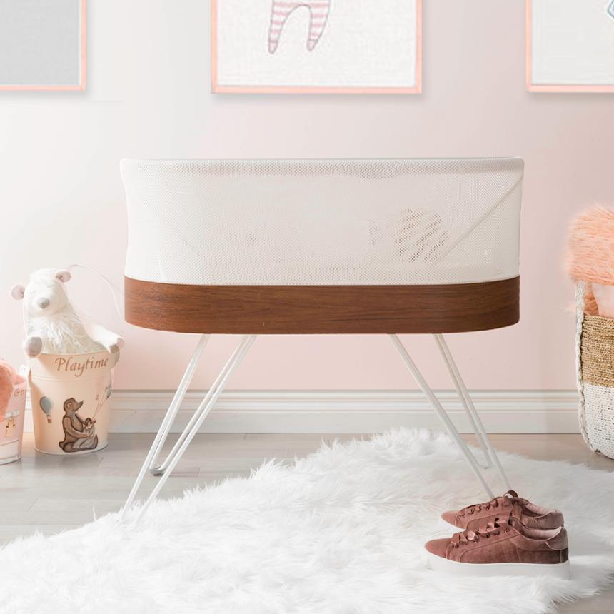 portable white cot with brown edging