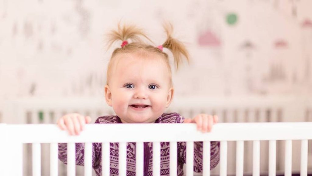 baby toddler in cot