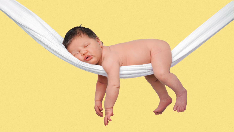 baby asleep on hammock