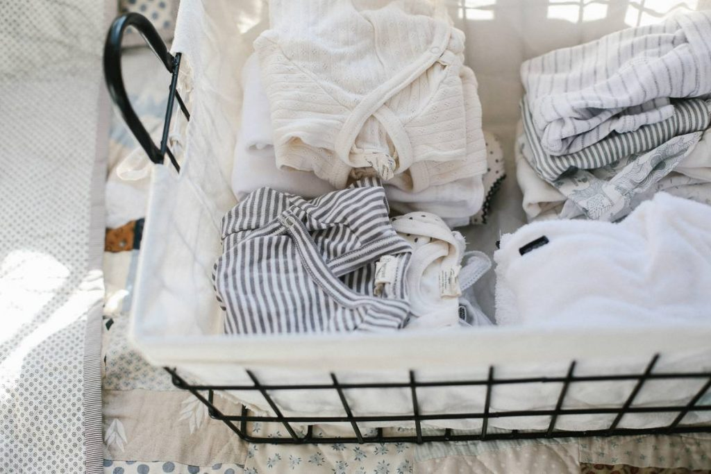 basket of clean baby clothes