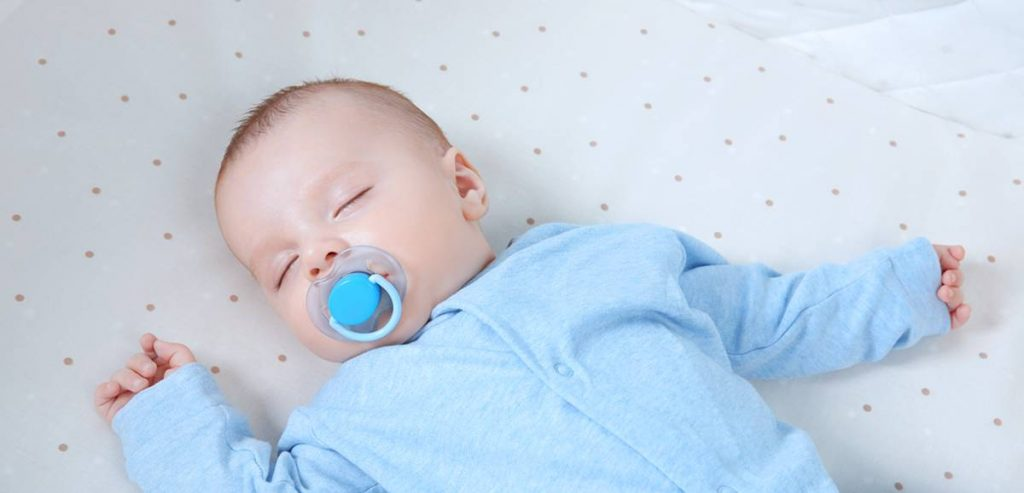 sleeping baby with dummy