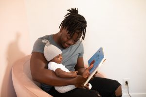 showing book to baby