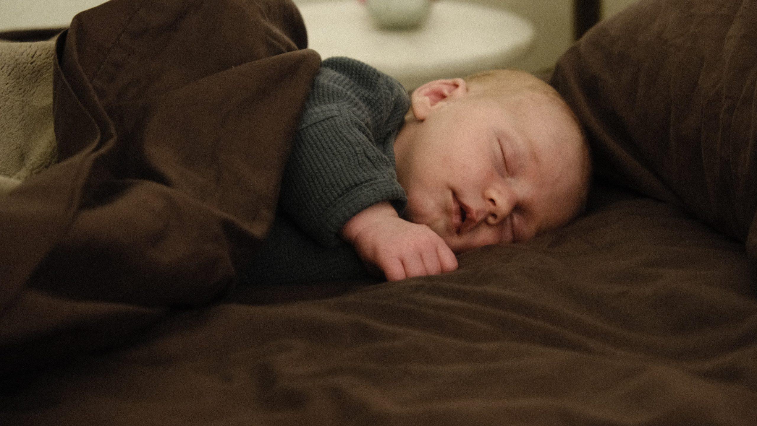 sleeping baby with balnket