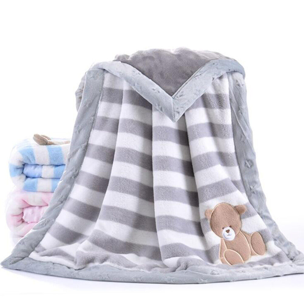 grey and white striped baby blanket